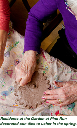 Residents at the Garden at Pine Run decorated sun tiles to usher in the spring.
