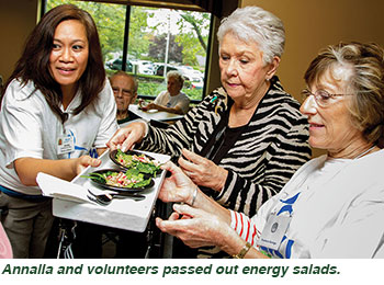 Annalia and volunteers passed out energy salads.