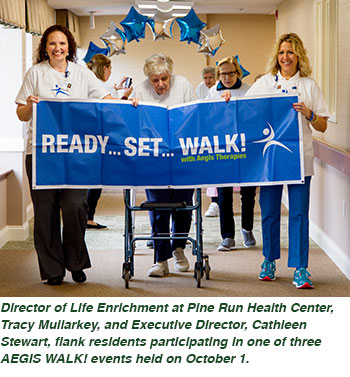 Director of Life Enrichment at Pine Run Health Center, Tracy Mullarkey, and Executive Director, Cathleen Stewart, flank residents participating in one of three AEGIS WALK! events held on October 1.