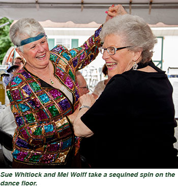 Sue Whitlock and Mel Wolff take a sequined spin on the dance floor.