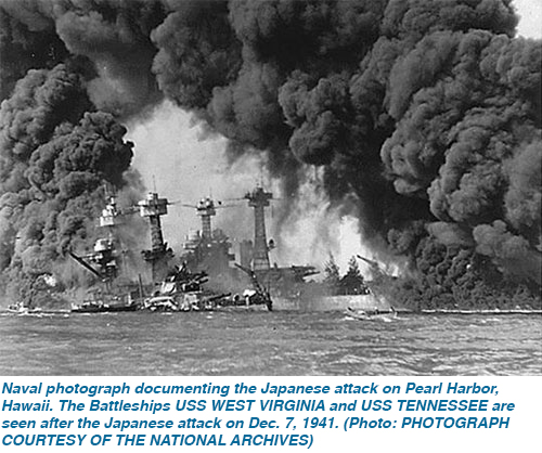 Naval photograph documenting the Japanese attack on Pearl Harbor, Hawaii. The Battleships USS WEST VIRGINIA and USS TENNESSEE are seen after the Japanese attack on Dec. 7, 1941. (Photo: PHOTOGRAPH COURTESY OF THE NATIONAL ARCHIVES)