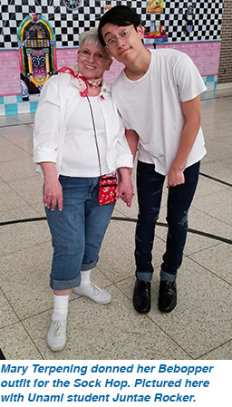 Mary Terpening donned her Bebopper outfit for the Sock Hop. Pictured here with Unami student Juntae Rocker.