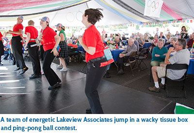 A team of energetic Lakeview Associates jump in a wacky tissue box and ping-pong ball contest.
