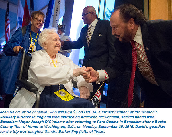 Jean David, of Doylestown, who will turn 95 on Oct. 14, a former member of the Women's Auxiliary Airforce in England who married an American serviceman, shakes hands with Bensalem Mayor Joseph DiGirolamo after returning to Parx Casino in Bensalem after a Bucks County Tour of Honor to Washington, D.C., on Monday, September 26, 2016. David's guardian for the trip was daughter Sandra Barkerding (left), of Texas.