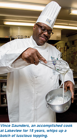Vince Saunders, an accomplished cook at Lakeview for 15 years, whips up a batch of luscious topping.