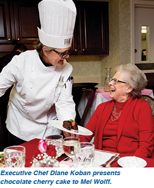 Executive Chef Diane Koban presents chocolate cherry cake to Mel Wolff.