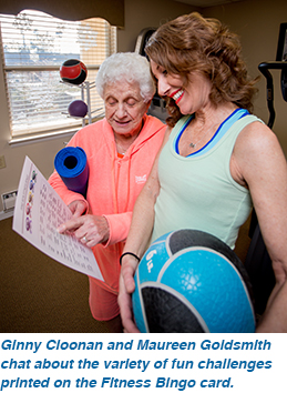 Ginny Cloonan and Maureen Goldsmith chat about the variety of fun challenges printed on the Fitness Bingo card.