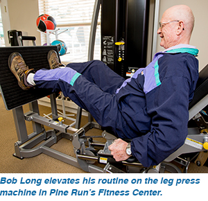 Bob Long elevates his routine on the leg press machine in Pine Run's Fitness Center.