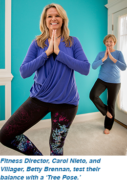Fitness Director, Carol Nieto and Villager, Betty Brennan, test their balance with a 'Tree Pose.'
