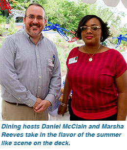 Dining hosts Daniel McClain and Marsha Reeves take in the flavor of the summer like scene on the deck.