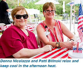 Donna Nicolazzo and Patti Bilinski relax and keep cool in the afternoon heat.