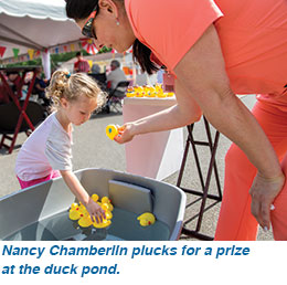 Nancy Chamberlin plucks for a prize at the duck pond.