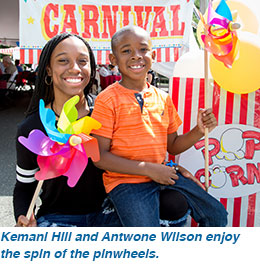 Kemani Hill and Antwone Wilson enjoy the spin of the pinwheels..