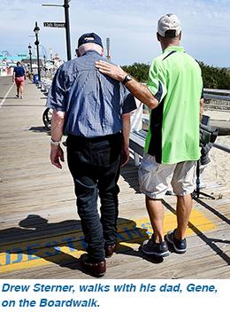 Drew Sterner, walks with his dad, Gene, on the Boardwalk.