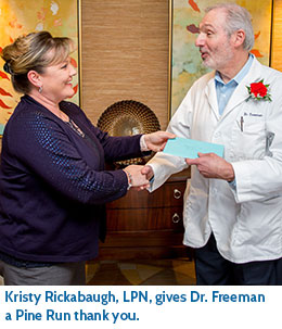 Kristy Rickabaugh, LPN, gives Dr. Freeman a Pine Run thank you.