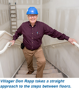 Villager Don Rapp takes a straight approach to the steps between floors. Elevators will offer a speedier alternative.
