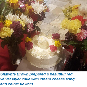 Shawnte Brown prepared a beautiful red velvet layer cake with cream cheese icing and edible flowers.
