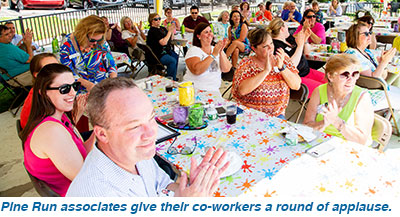 Pine Run associates give their co-workers a round of applause.