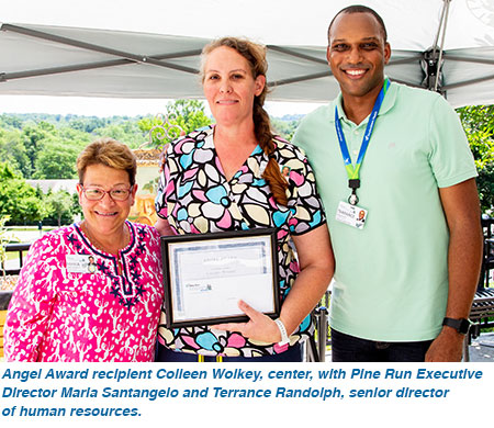 Angel Award recipient Colleen Wolkey, center, with Pine Run Executive Director Maria Santangelo and Terrance Randolph, senior director of human resources.