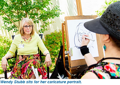 Wendy Stubb sits for her caricature portrait.