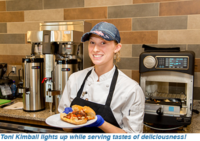 Toni Kimball lights up while serving tastes of deliciousness!