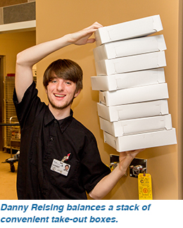 Xx balances a stack of convenient take-out boxes.
