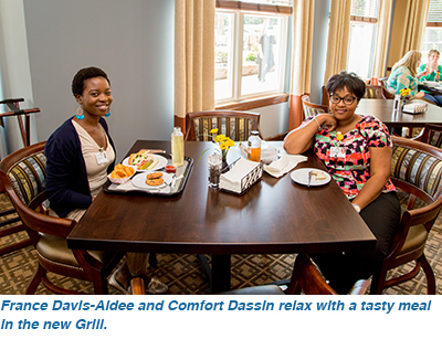 France Davis-Aidee and Comfort Dassin relax with a tasty meal in the new Grill.
