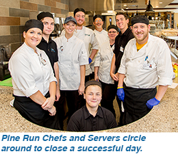 Pine Run Chefs and Servers circle around to close a successful day.