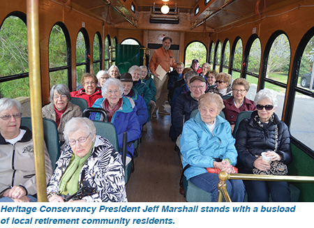 Heritage Conservancy President Jeff Marshall stands with a busload of local retirement community residents.