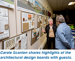 Carole Scanlon shares highlights of the architectural design boards with guests.