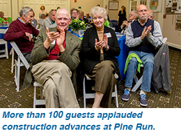 More than 100 guests applauded construction advances at Pine Run.