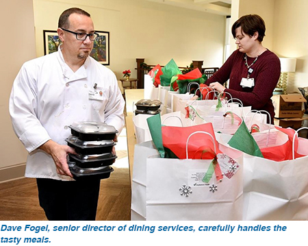 Dave Fogel, senior director of dining services, carefully handles the tasty meals.