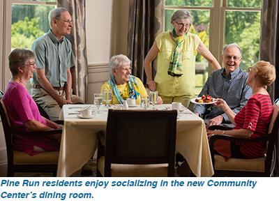 Pine Run residents enjoy socializing in the new Community Center's dining room.