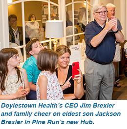 Doylestown Health's CEO Jim Brexler and family cheer on eldest son Jackson Brexler in Pine Run's new Hub.