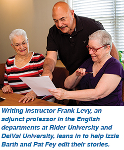 Writing instructor Frank Levy, an adjunct professor in the English departments at Rider University and DelVal University, leans in to help Izzie Barth and Pat Fey edit their stories.
