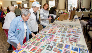 Visitors and villagers browse the marketplace at Pine Run Retirement Community's Fall Festival. Almost 30 Bucks County artisans displayed and sold their original designs and creations.