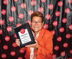 Executive Director Maria Santangelo proudly accepts a Best of Bucks award for Pine Run Retirement Community.